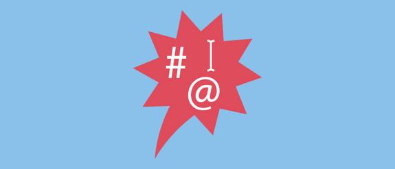 Grafik einer Sprechblase mit Hashtag, @ und Cursor