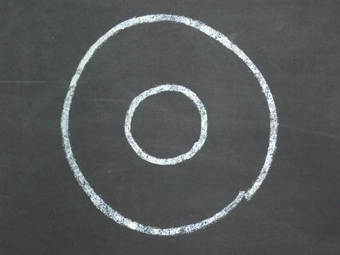 Zwei weiße Kreise auf einem schwarzen Hintergrund
